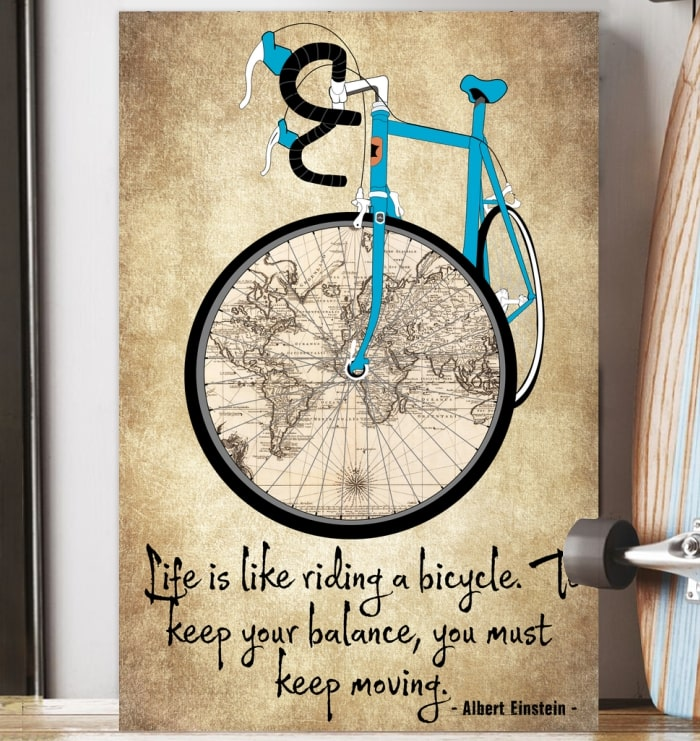 life is like riding a bicycle to keep your balance you must keep moving cycling vintage poster 4