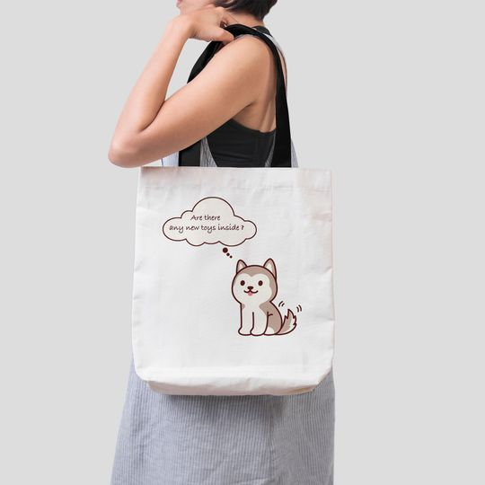 husky dog are there any new toys inside tote bag 3